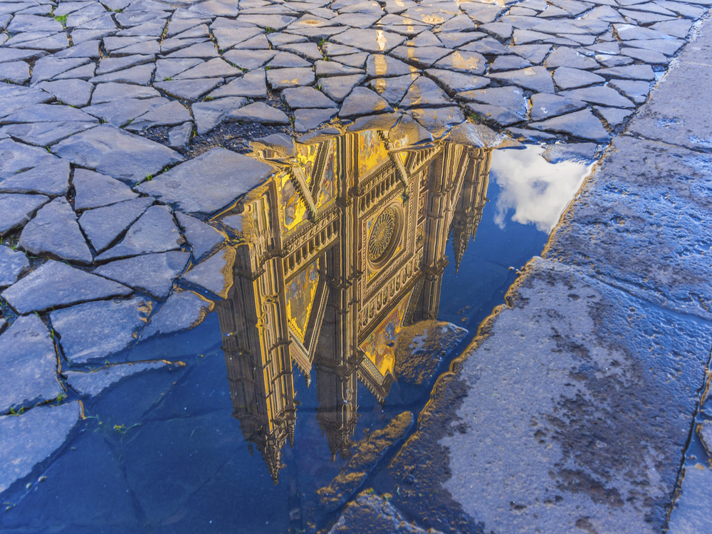 Orvieto cathedral in a water puddle umbria