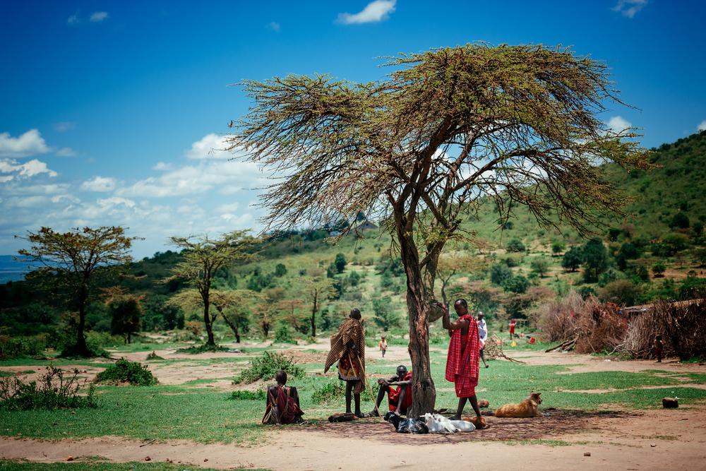 People sittiing in masai village on October 02 2013 in Masai MaraKenya