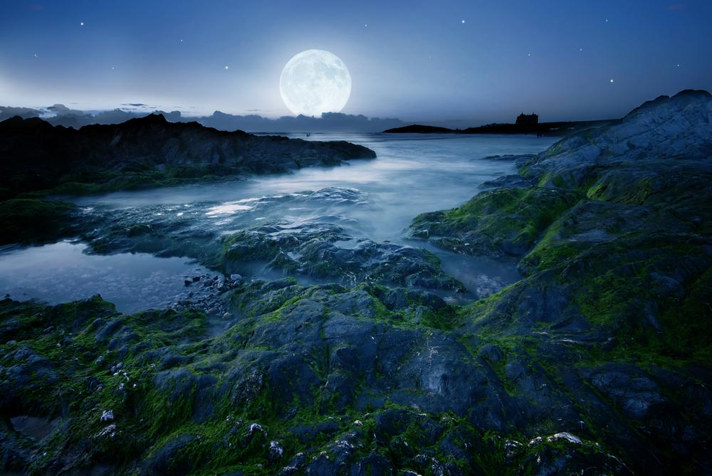 moon over the coast in Cornwall UK