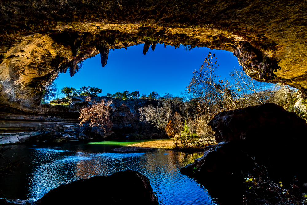 A View of Beautiful Hamilton Pool Texas in the Fall inside the Grotto of the Sinkhole