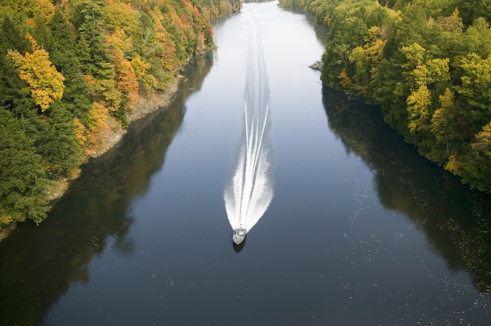 A boat navigates the Connecticut River on the Mohawk Trail of western Massachusetts New England