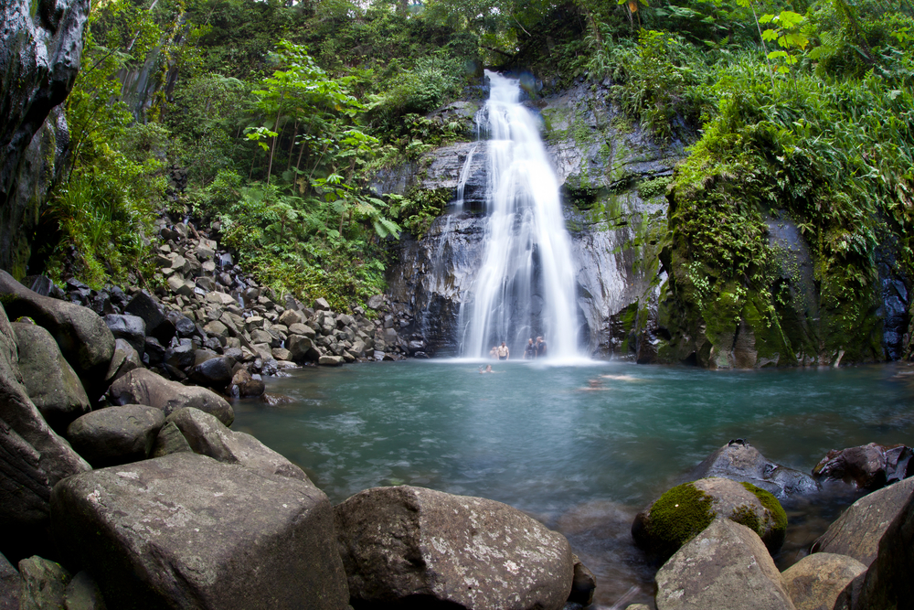 A waterfall cascades into a large pool on Cocos Island Costa Rica
