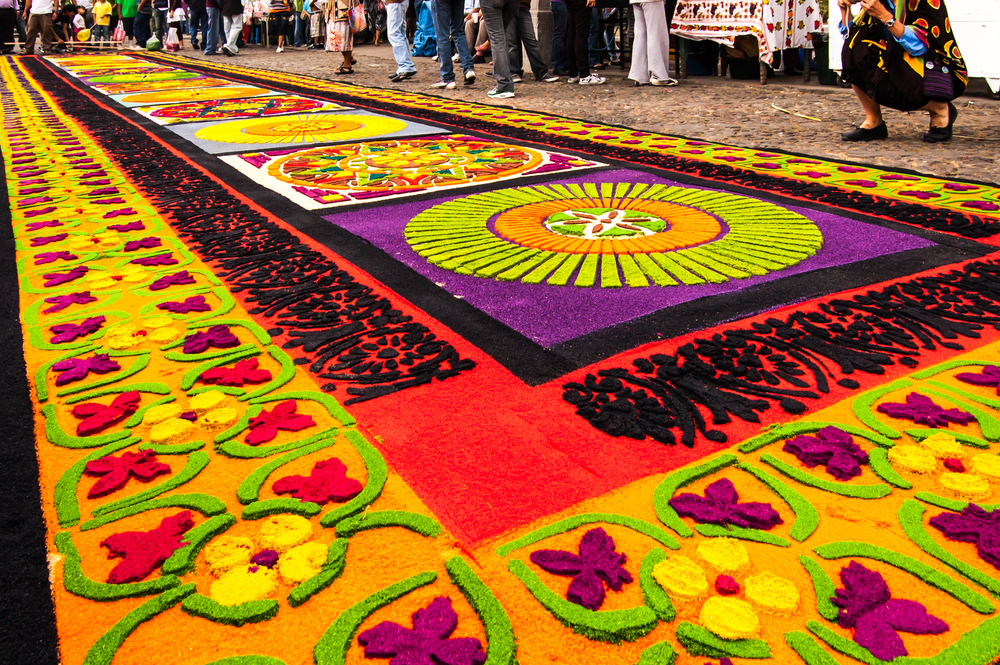 ANTIGUA GUATEMALA APRIL 17 2011 Holy Week carpet or alfombra made in the path of religious processions using wooden or cardboard stencils and dyed sawdust