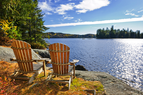 Adirondack chairs at shore of Lake of Two Rivers Ontario Canada