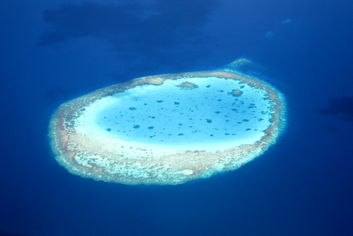 Aerial view of an atoll in the azure blue South Pacific