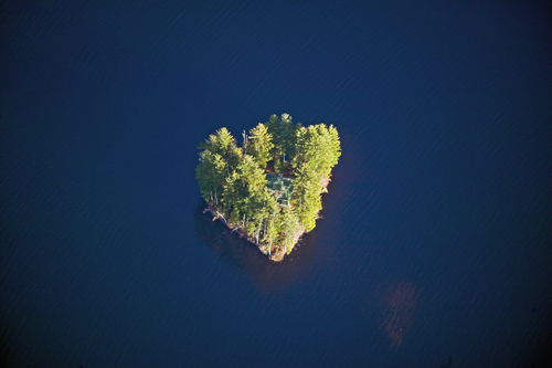Aerial view of heart shaped island with a house in Maine