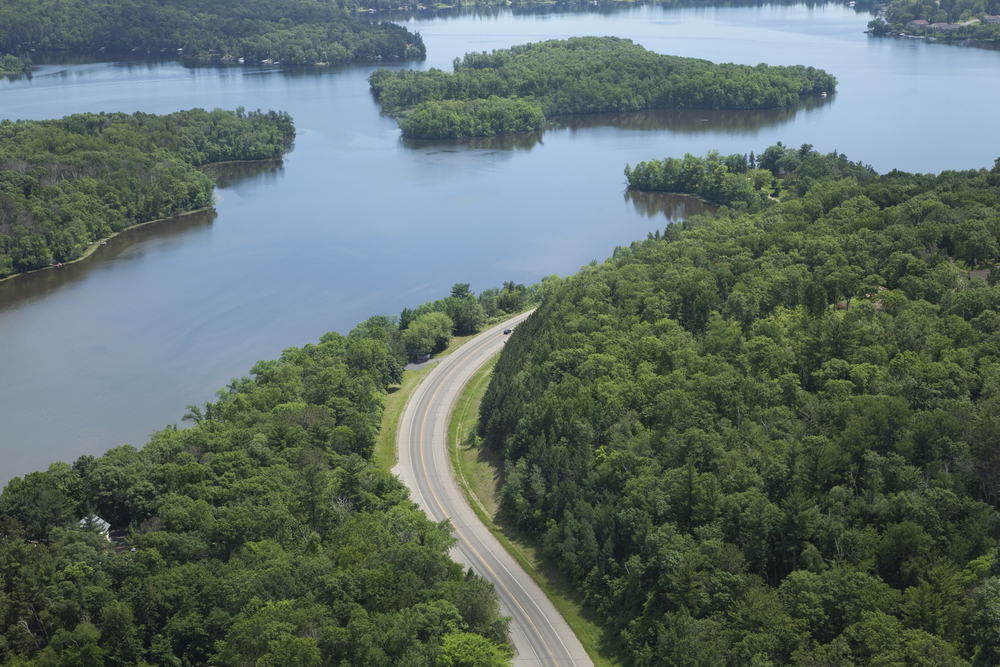 Aerial view of the Mississippi River and a curving road near Brainerd Minnesota