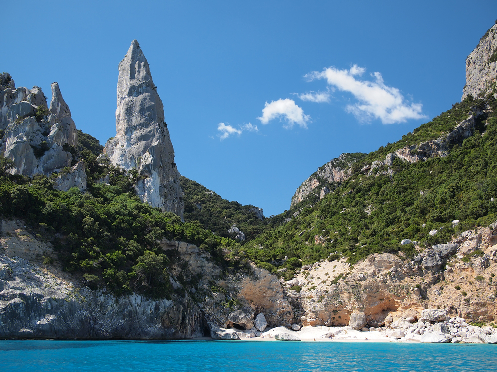 Aguglia pinnacle famous for rock climbing on the deserted Cala Goloritze beach only accessible by boat in the Gulf of Orosei Golfo di Orosei in Sardinia Italy
