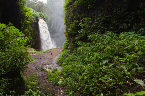 Air Terjun water fall Borneo Indonesia Raw water from Kawah Ijen volcano