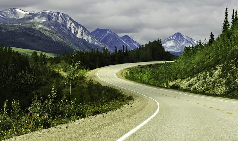 Alaska Curved asphalt road in high mountains