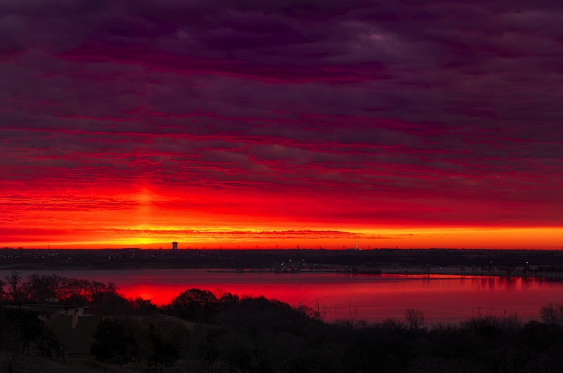 Amazing crimsonred sunrise over Benbrook Lake in Fort worth
