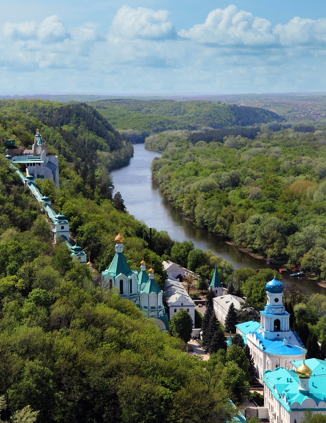 Amazing landscape with Orthodox monastery on the hills over the river