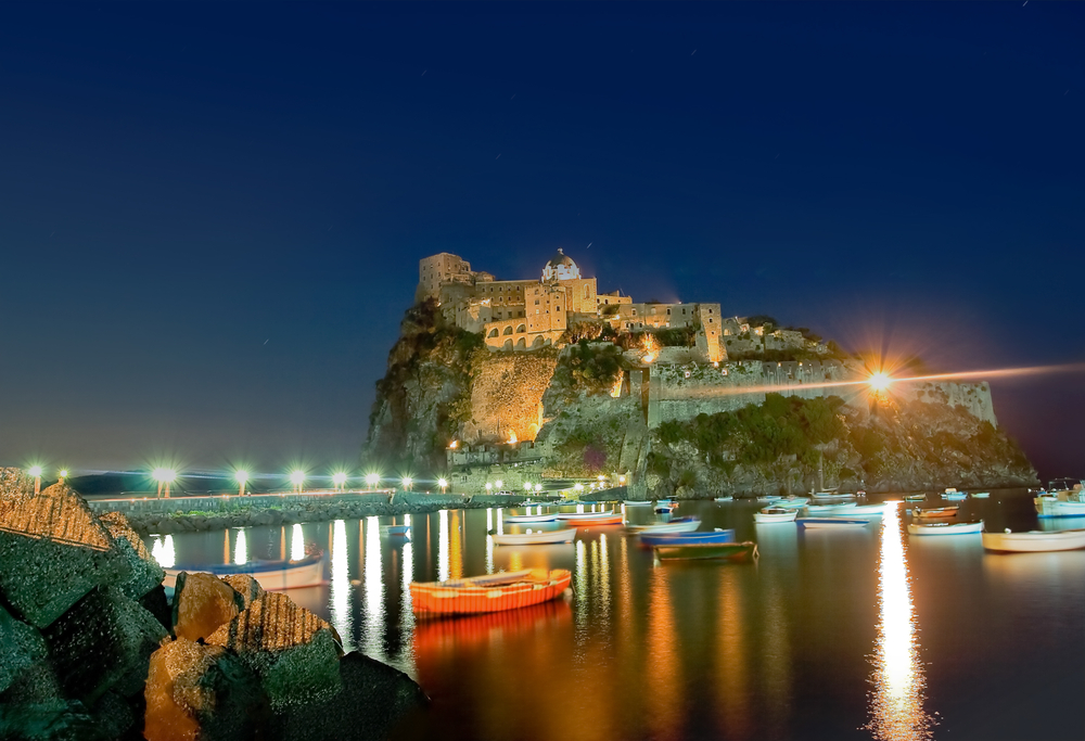 Ancient hotel and castle in Ischia island Italy at night