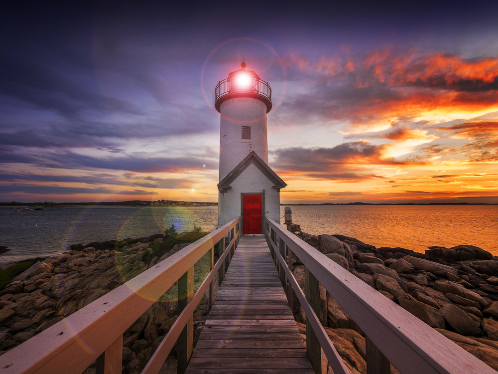 Annisquam lighthouse at sunset off the coast of Gloucester MA