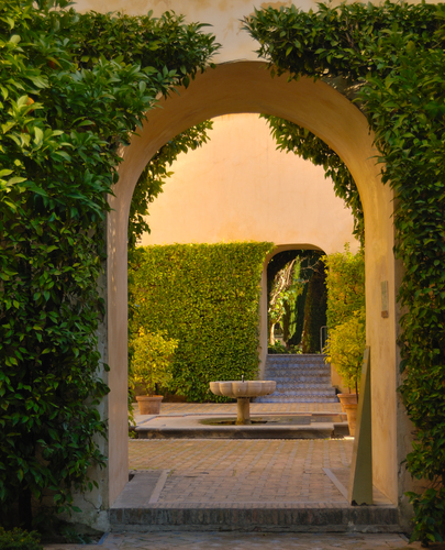 Arch in the gardens of the Alcazar Seville Spain