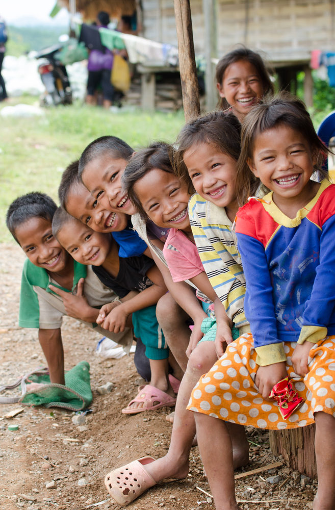 BAN NONG KHAM VIANGPHOUKHA LUANGNAMTHA LAO P D R JUNE 2 Unidentified Khmu ethnic kids 7 10 years old smile by the R3A route on June 22013 in ViangphoukhaLuangn
