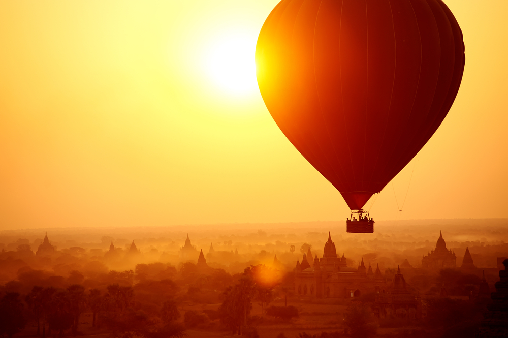 Bagan in Myanmar tourists watching sunrise over ancient city birmania