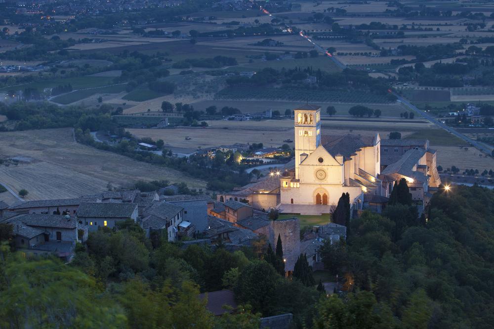 Basilica San Francesco of Assisi church at evening Umbria Italy