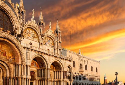 Basilica di San Marco and Monastery of San Giorgio under very dramatic sunset Venice Italy