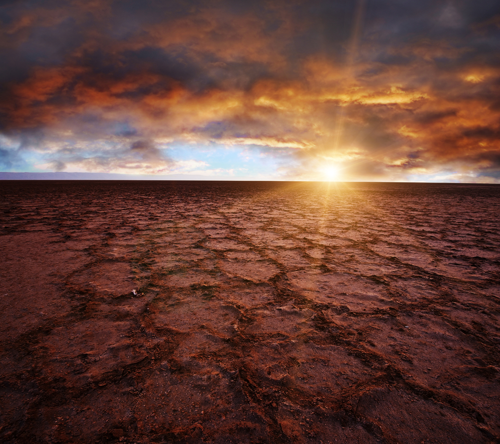 Beautiful dramatic sunrise over great dried up salt lake Chott el Djerid in Tunisi