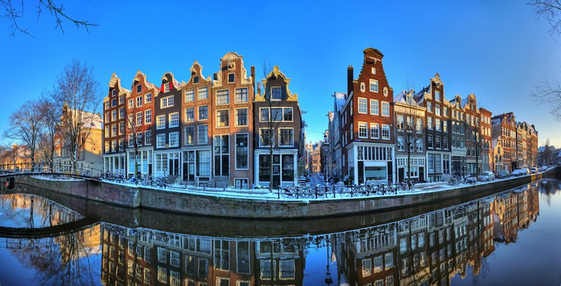 Beautiful early morning winter panorama of the Unesco world heritage city canals of Amsterdam The Netherlands