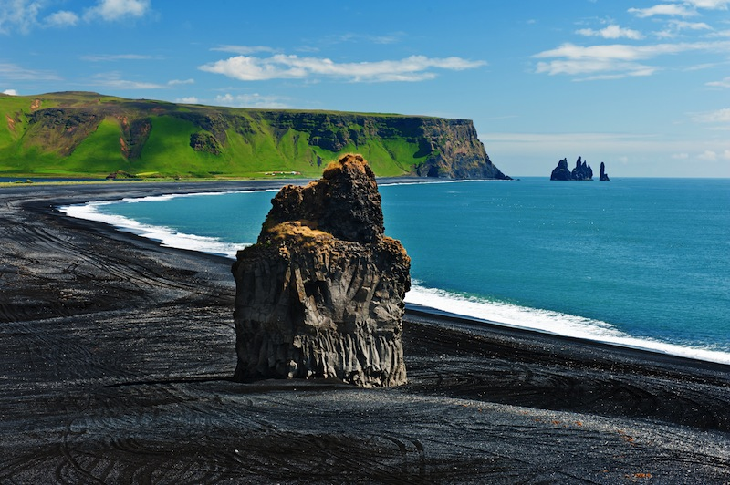 Beautiful rock formation on a black volcanic beach at Cape Dyrholaey the most southern point of Iceland