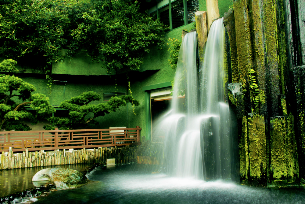 Beautiful waterfall in Chinese Classical Garden called Nan Lian in Hong Kong situated on the Kowloon Island