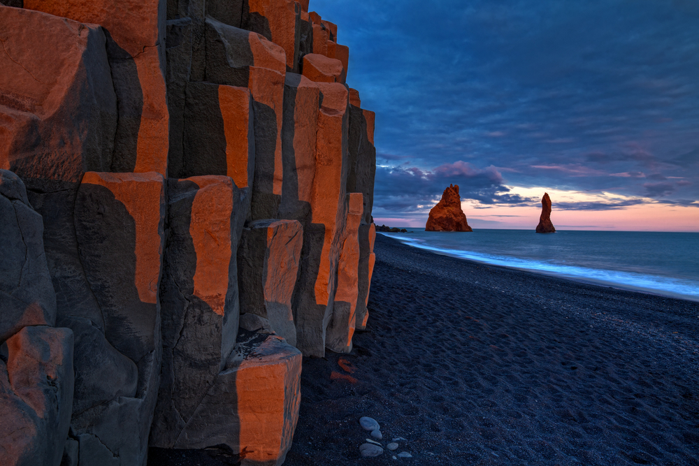 Black sand beach and basalt columns where puffins nest near Vik at South Coast of Iceland Island