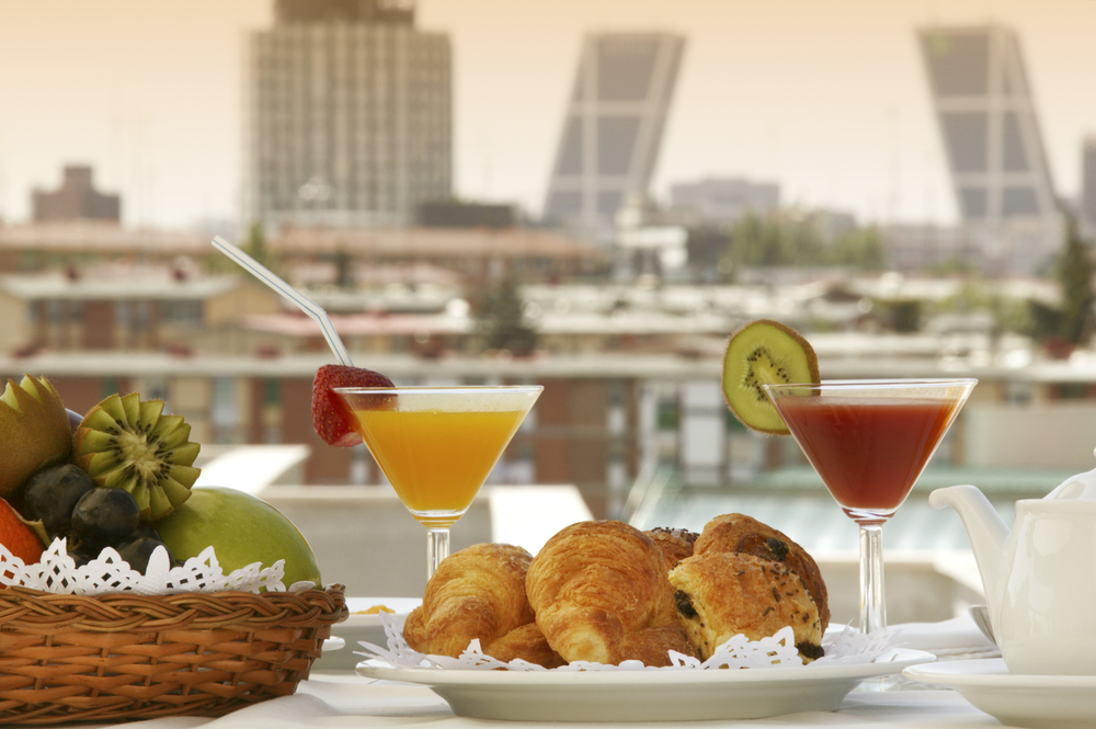 Breakfast in a terrace of Madrid Hotel with buildings in the background