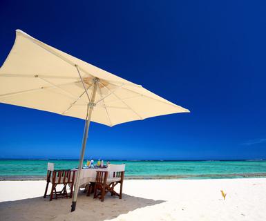Breakfast on tropical white sand beach in Mauritius Island