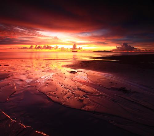 Burning sunset at the Tanjung Aru beach Borneo Kota Kinabalu Sabah Malaysia