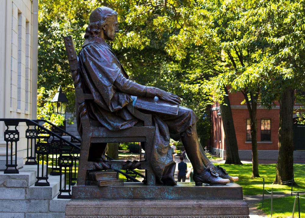 CAMBRIDGE USA SEPTEMBER 14 2012 John Harvards statue in the Harvards campus in Cambridge