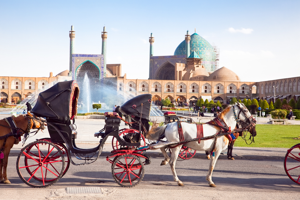 Carriage with horses on Naqsh i Jahan Square on sunny day Isfahan Iran