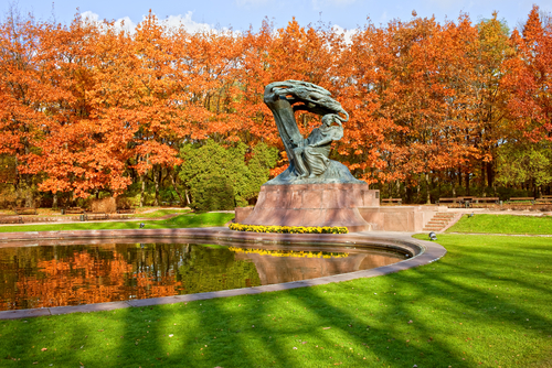 Chopin statue in autumn at Royal Baths Park Lazienki Park in Warsaw Poland designed around 1904 by Waclaw Szymanowski 1859 1930