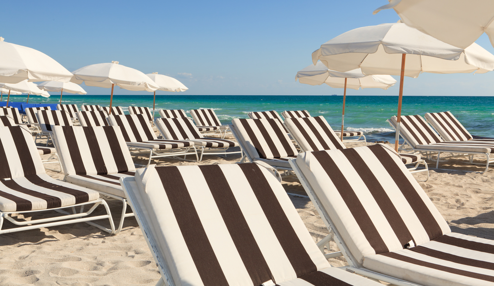 Colorful umbrellas and lounge chairs on Miamis South Beach