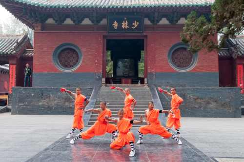 DENGFENGHENANCHIN A OCTOBER 21 The group of Shaolin kungfu performs at Shaolin Temple on October 212013 in Dengfeng of Henan Province China