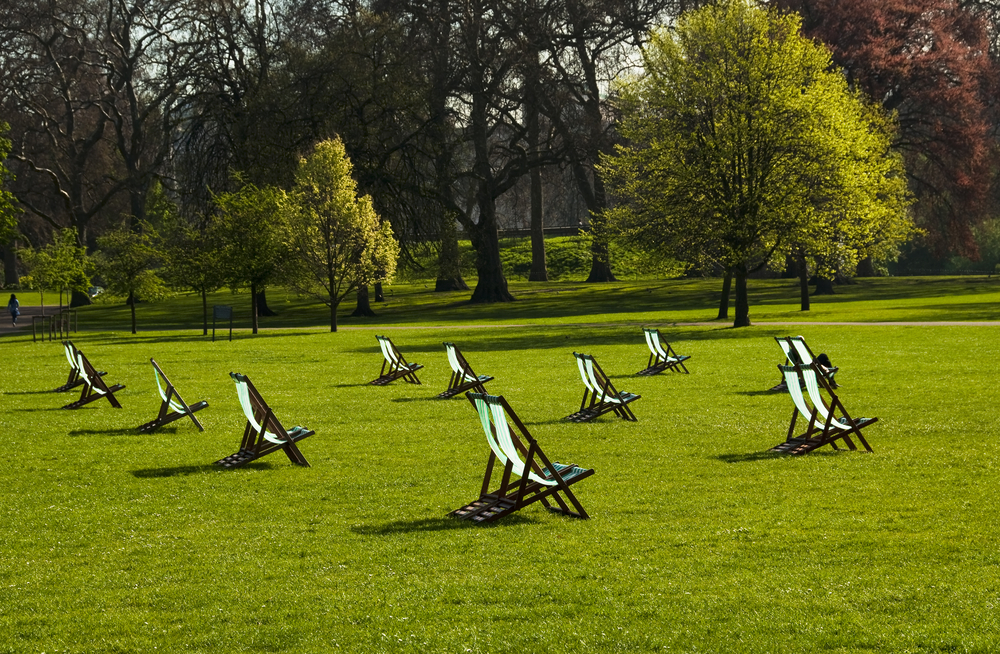 Deck chairs in St Jamess Park in spring London UK 1