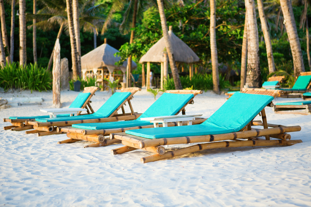Deckchairs at the perfect white sand beach on Boracay Philippines
