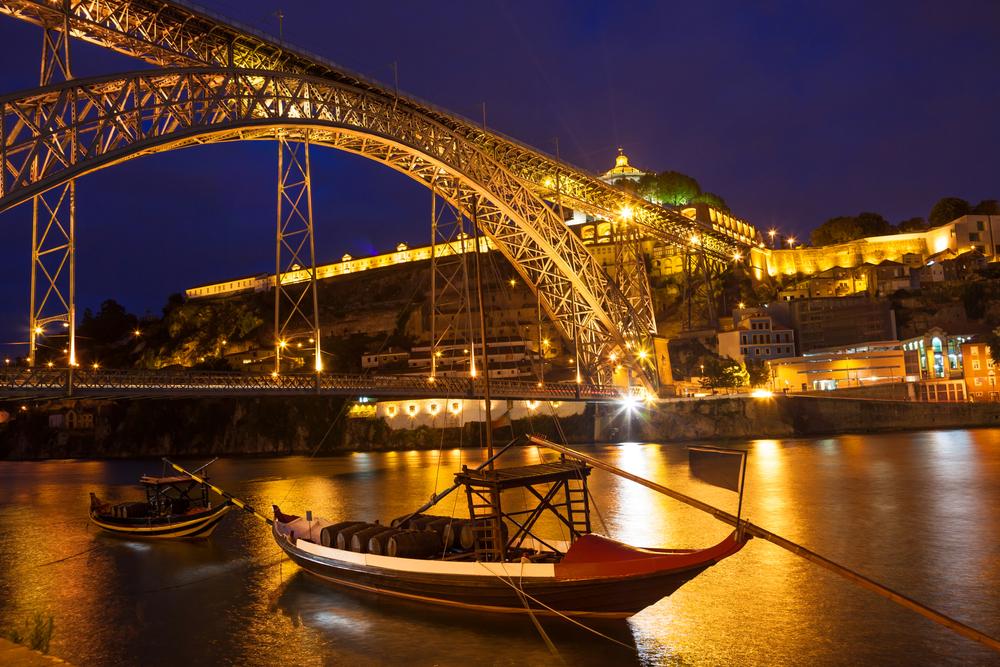 Dom Luis I bridge over Douro river and monastery of Serra do Pilar illuminated at night