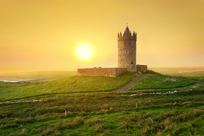 Doonagore castle at sunset Co
