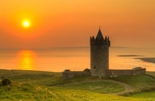 Doonegore castle at sunset in Doolin Ireland