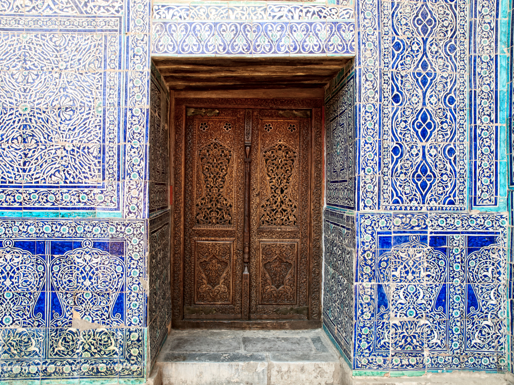 Door and wall with traditional floral decoration in Khiva