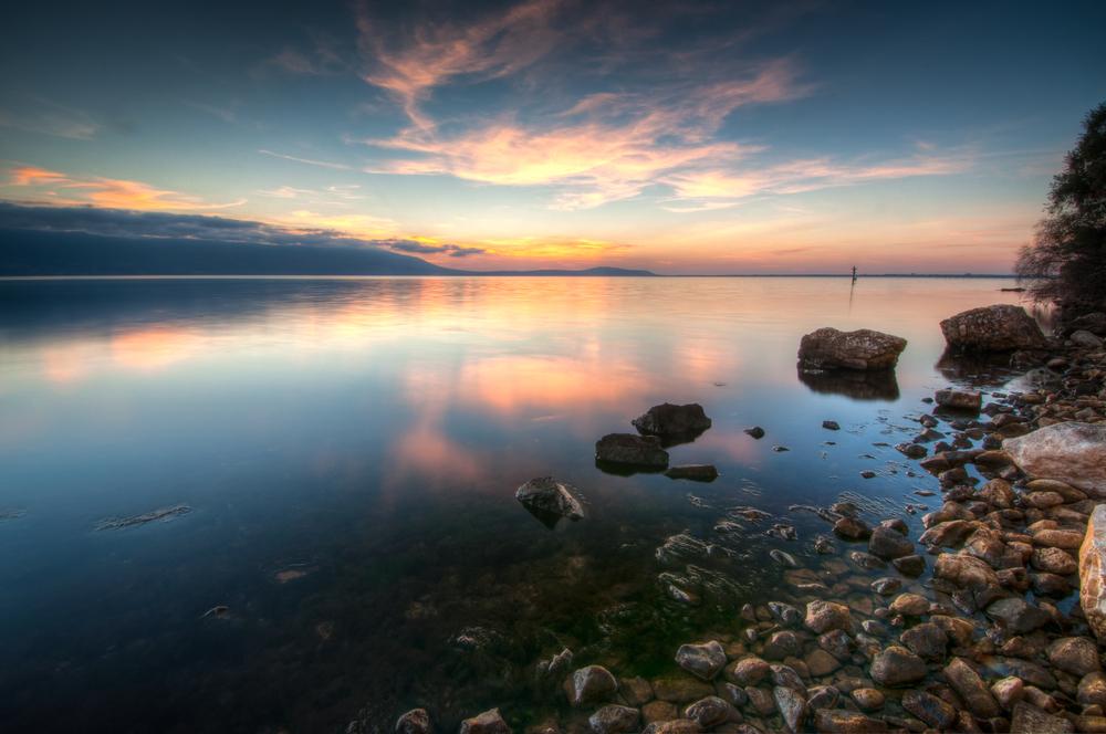 Dusk at Lago di Varano Varano lake on the Gargano peninsula in Puglia Italy