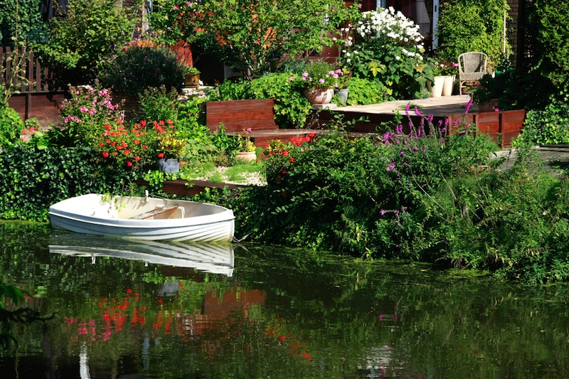 Dutch flower garden with boat on a canal Amsterdam