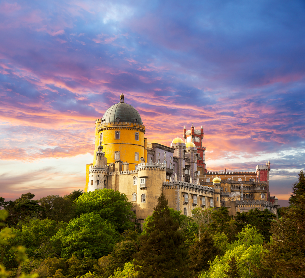Fairy Palace against sunset sky  Panorama of Pena National Palace in Sintra Portugal  Europe