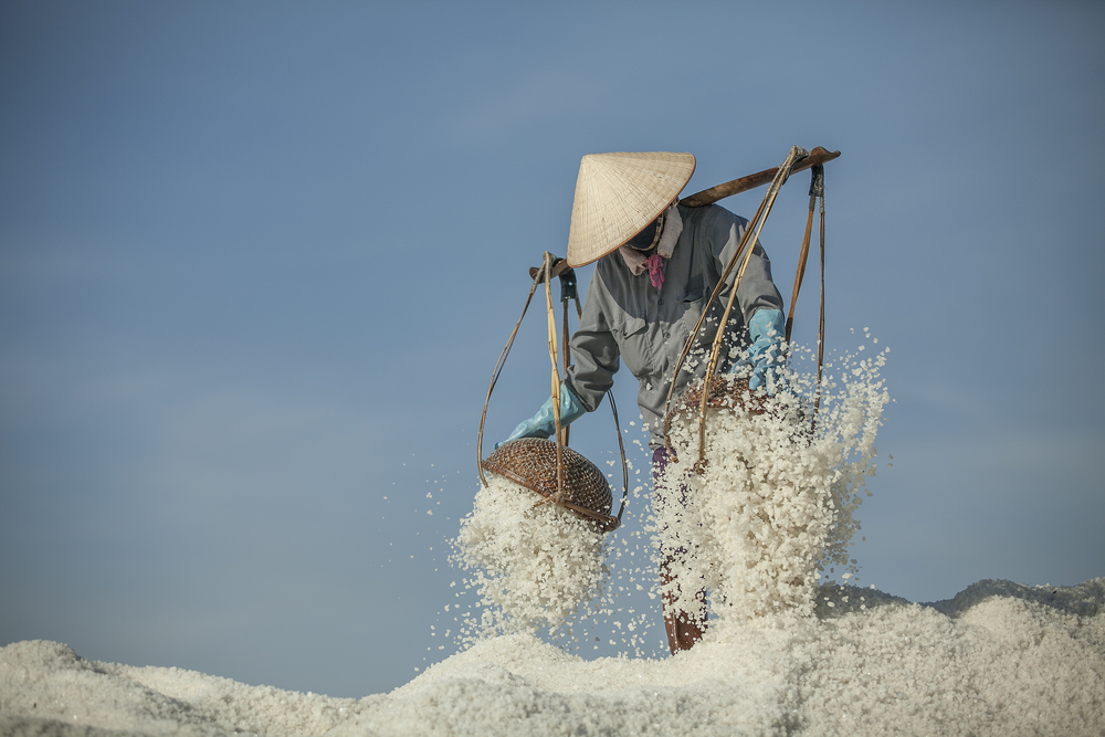Farmers carrying the salt on the baskets in Nha Trang Vietnam 2