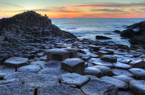 Giants Causeway in Northern Ireland Unesco world heritage site at sunset