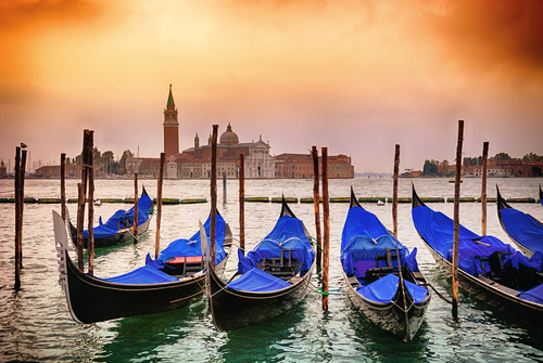 Gondolas moored by Saint Mark square with San Giorgio di Maggiore church in the background Venice Venezia Italy Europe