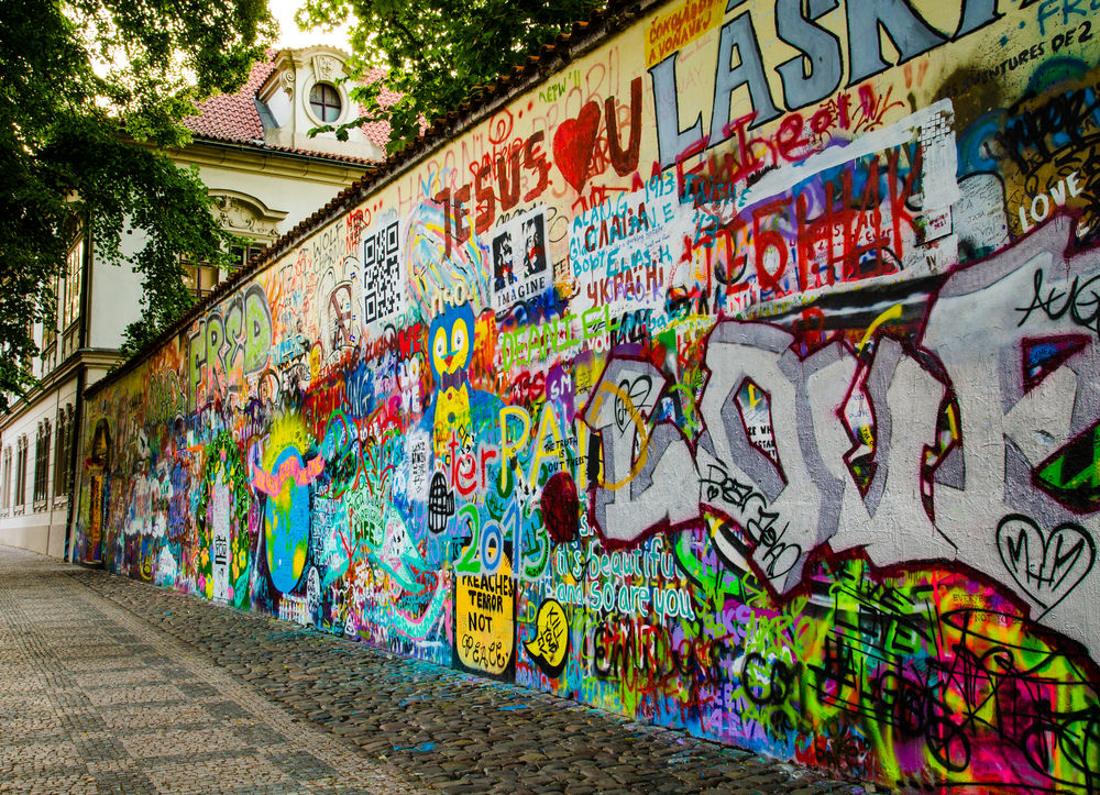 Graffiti Wall next to a historic building in Old Prague