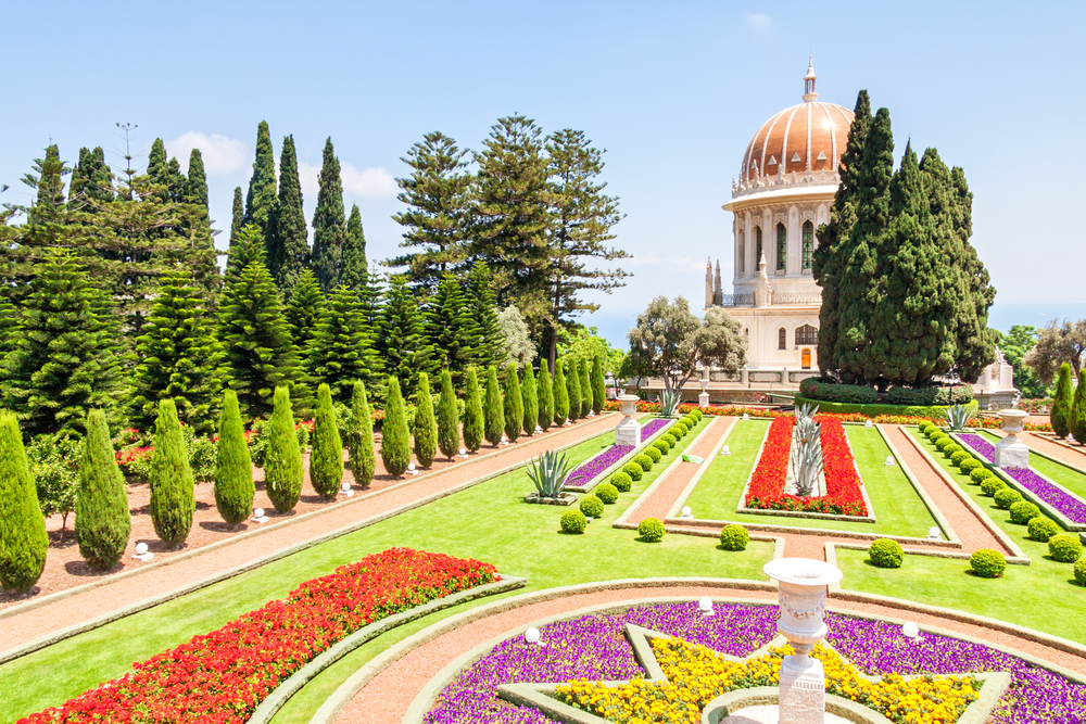 HAIFA ISRAEL JULY 17 View on Shrine of Bab with beautiful Bahai garden and blossoming flowers in star form flowerbed on July 17 2008 in Haifa